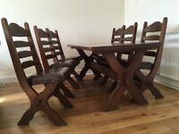 Solid oak dining table with leather upholstery on the 6 chairs. Carmarthen SA31