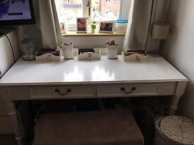White solid wood desk.