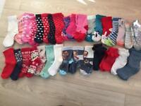 32 pairs of girls socks. Shoe size 6.5-8 (infant)
