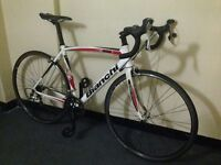 bianchi via nirone 7 entry level road bike carbon fork puncher proof tyres like specialized boardman
