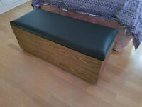 Wooden ottoman with faux leather lid