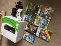 Xbox 360 boxed, 7 games, headset, 2 controllers and plug and play orb battery pack!