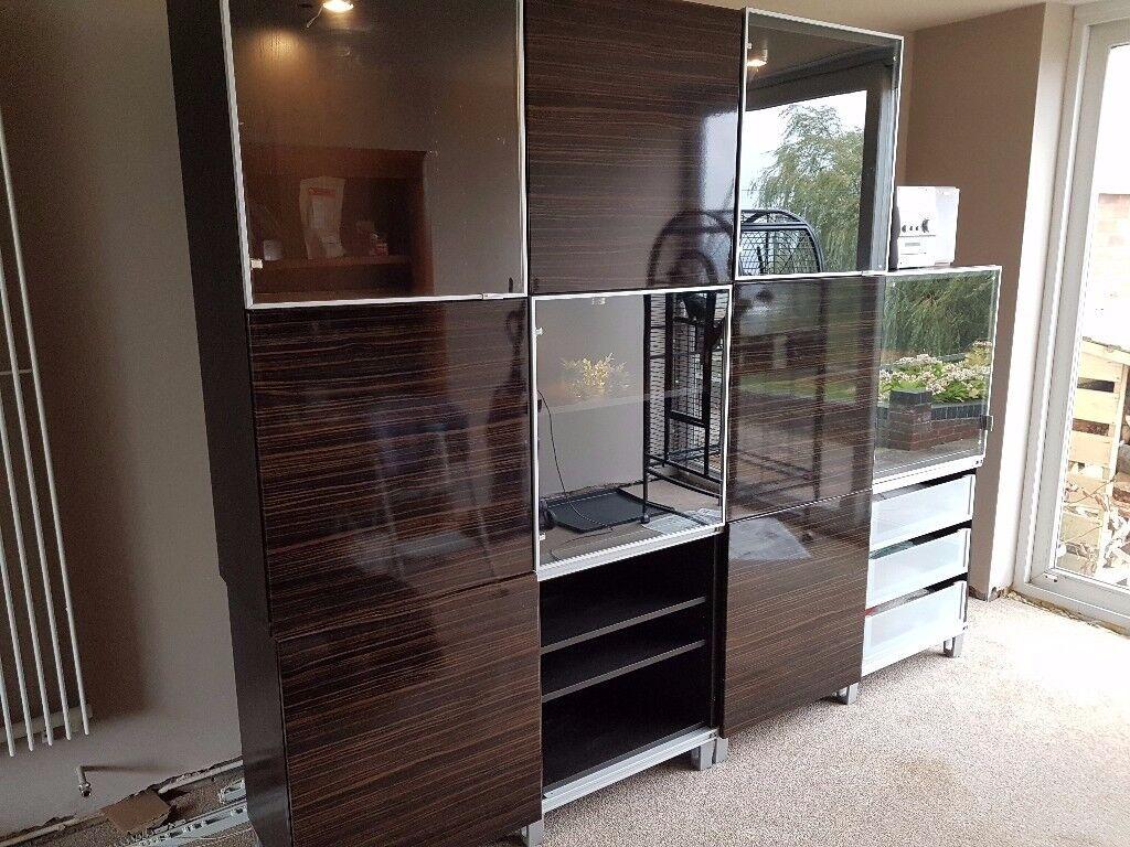 Ikea wall unit. Loads of storage space. 4 illuminated cabinets. 240(L) 200(H) 41(D) cm