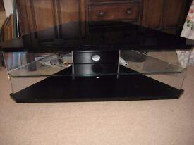 """Black glass corner TV stand max TV 40""""."""
