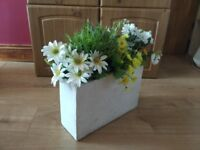 Large flowerpot with artificial flowers