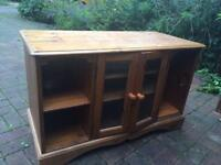 Pine TV cabinet with glass doors.