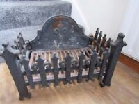 Cast iron ornate fire grate with Fluer De Leys backplate in great condition