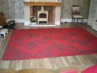 Large Red and Black Rug.