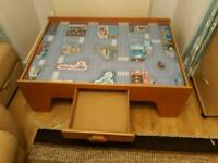 Children's play table with train and car tracks