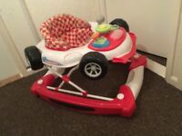 Racing car baby walker with steering wheel makes noises as well