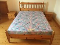 Pine double bed with mattress.