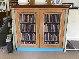 Pine cupboard with novelty doors