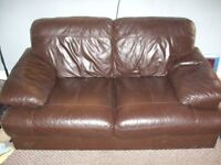 Dark brown leather three seater sofa in good used condition.
