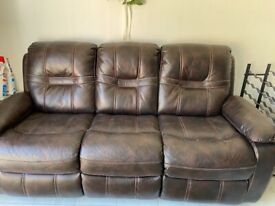 Free leather settee with reclining leg rests