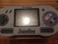 Hyperkin supaboy plays snes Super Nintendo games