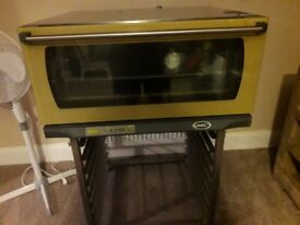 Electric fan oven on stand