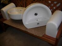 Two wall mounted sinks