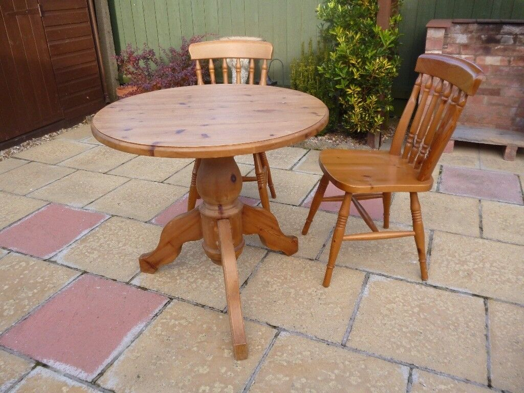 "Pine table and two chairs - table is 30"" diameter"