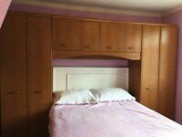 Overbed wardrobe unit with drawer by Alstons