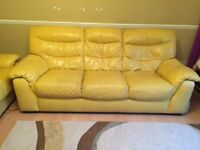 Yellow 3 seat leather sofa in reasonable condition