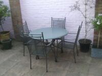 Round table, 106cm round, 73cm high. PERFECT CONDITION With four metal frame chairs all with arms.