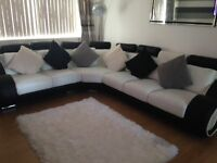 Black and white faux leather corner sofa for sale. £500 ONO.