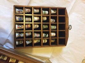 Thimbles (75 assorted) in wooden wall display cases -