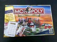 Opened but never played or got the bits out...monopoly here and now.