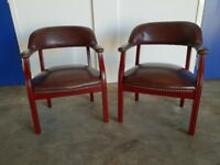 PAIR OF CAPTAINS CHAIRS IN BROWN VINYL OCCASIONAL CHAIRS WITH MAHOGANY FINISH DELIVERY AVAILABLE