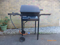 Char Broil Barbeque. Model CB-90DLX. Powered by calor gas. Has sideburner.
