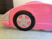 Pink racing car bed
