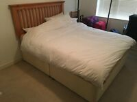 Double bed with Dreams mattress and wooden headboard for sale in good condition