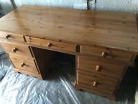 Wooden pine office desk for sale. Includes 7 drawers, 3 down either side & 1 middle drawer.