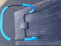 Abdominal exerciser/roller