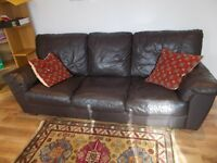 black leather sofa in nice condition