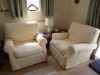 Two Arm Chairs with 2 Sets of Loose Covers