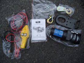 Brand New 2 Tonne Electric Winch Unused. Comes with remote cable control Fixed or Tow Bar Attachment