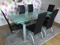 Solid glass topped dining table & chairs