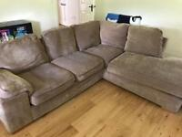Brown fabric corner sofa and footstool