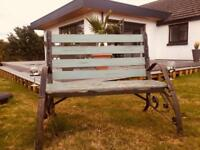 Garden bench with wine glass holders