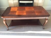 Elegant solid wood coffee table with marquetry top and lower shelf