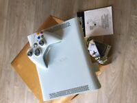 Xbox 360 + 8 games.