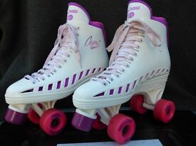 Adult Roller Skates. Size 6. White with pink and purple. Includes free skate bag.