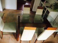 Glass table with 6 cream leather dining chairs solid wood base