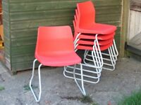 Orange Poly stacking chairs x 5 for students / adults with 'sled' style base