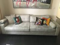 Comfortable, large sofa in light grey fabric