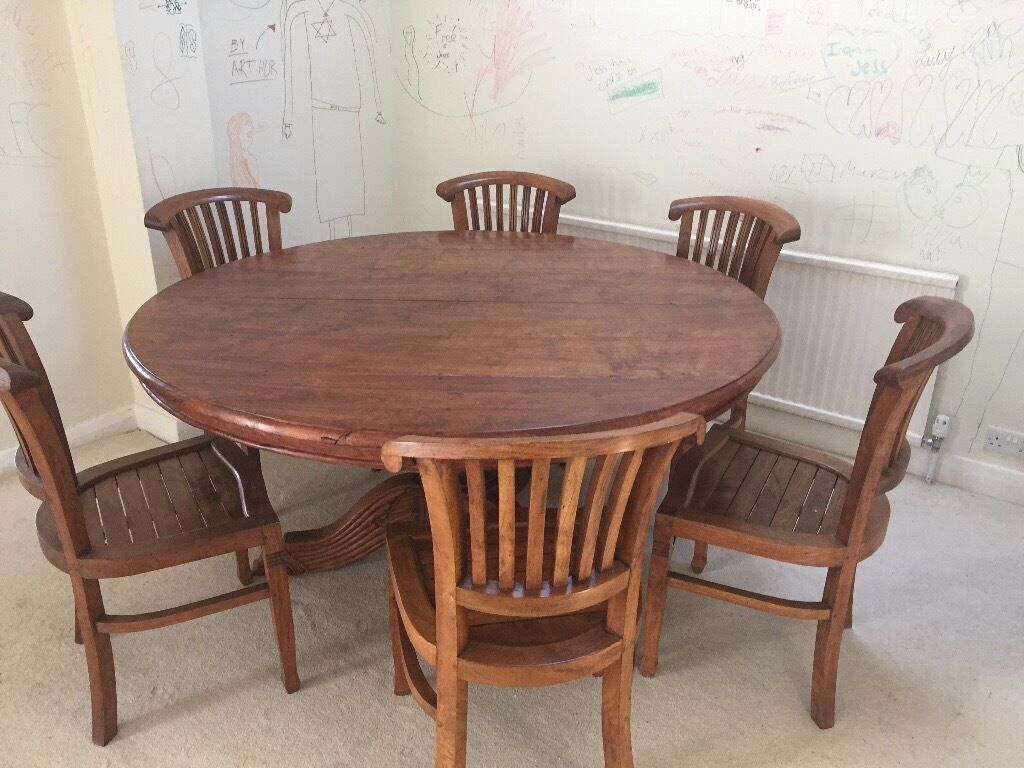Indonesian solid teak wood round dining table and 8 chairs for Solid wood round tables dining