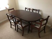 Oval extendable dining table with 6 chairs