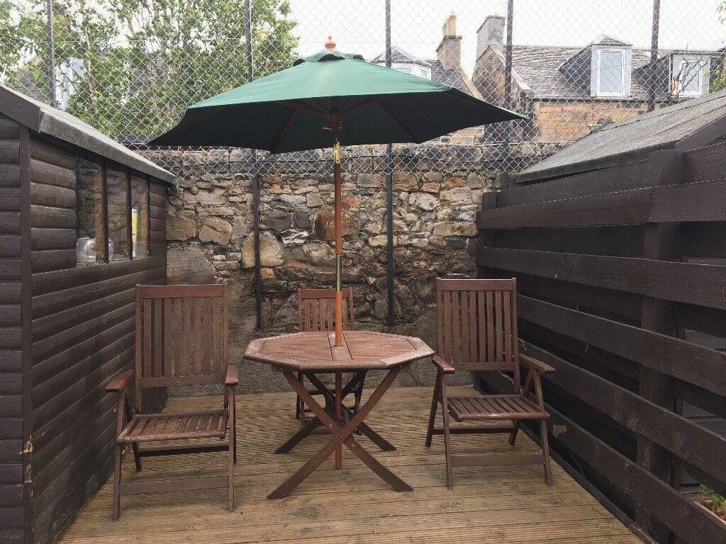 Wooden garden table chairs umbrella
