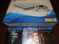 brand new white slim ps4 console and 3 games